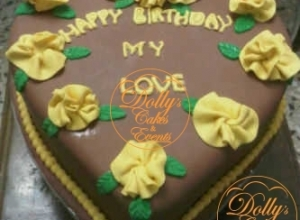 Yellow and Brown Heart Shaped Cake with Flower